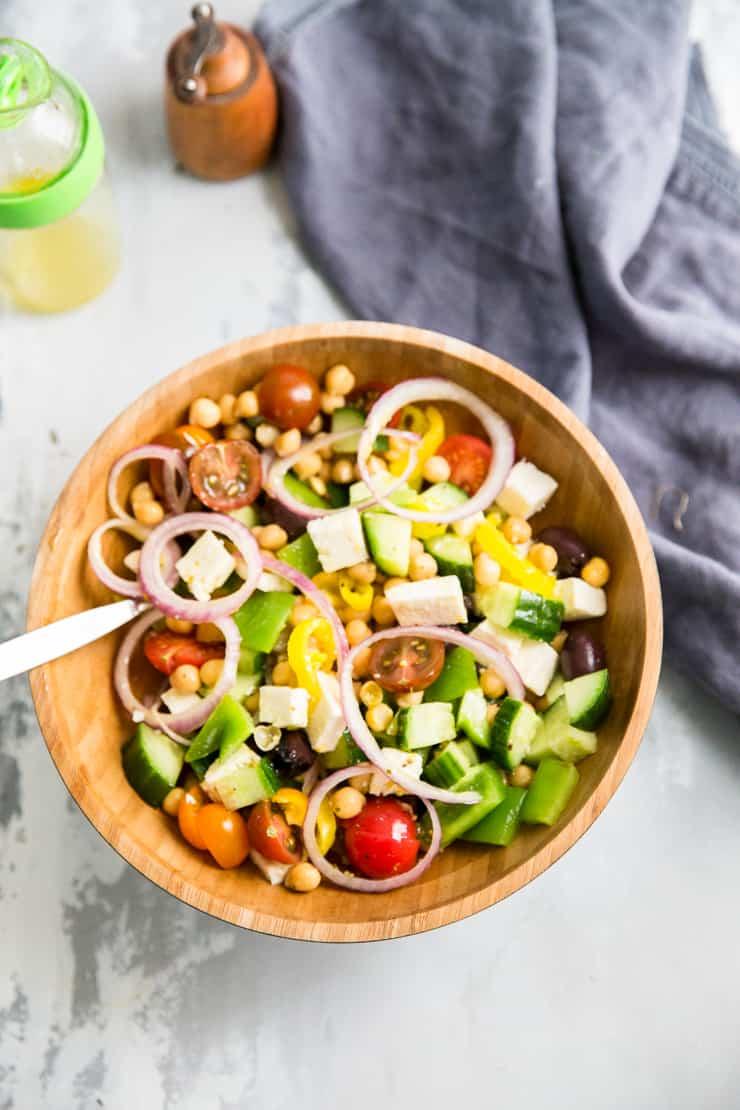 Geek salad in a wood bowl
