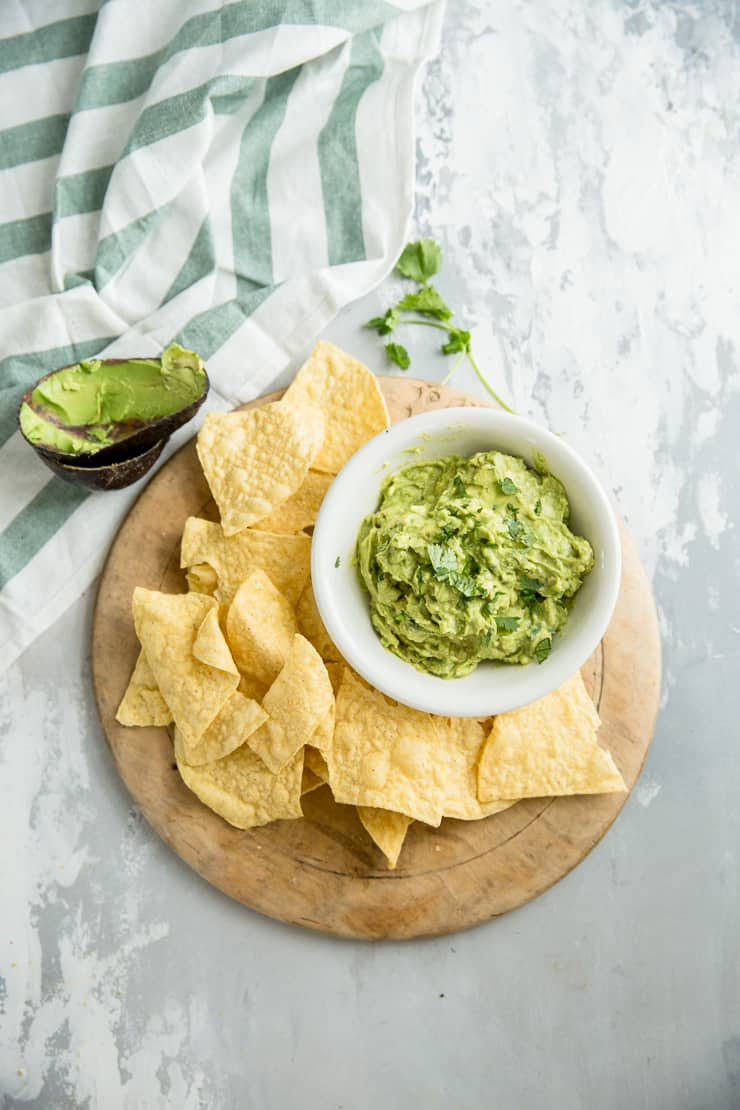 easy guacamole recipe with chips on the side
