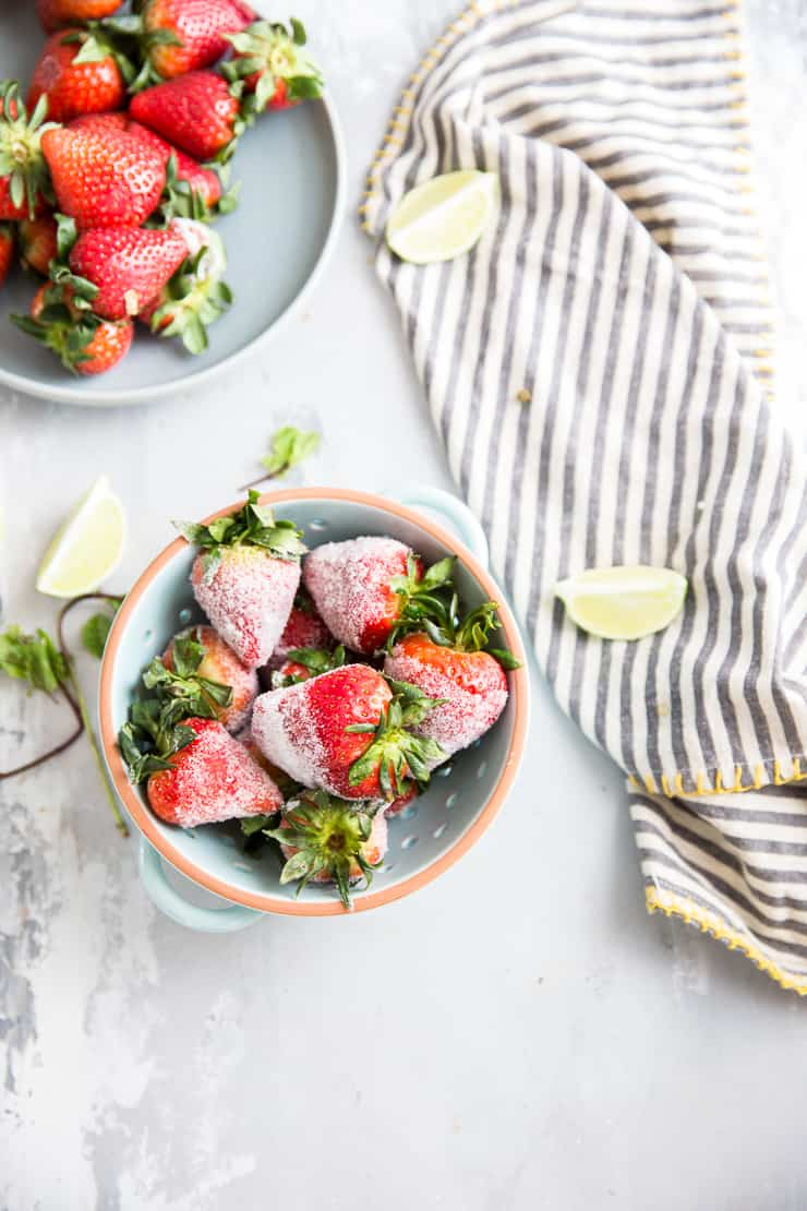infused strawberries in a blue bowl