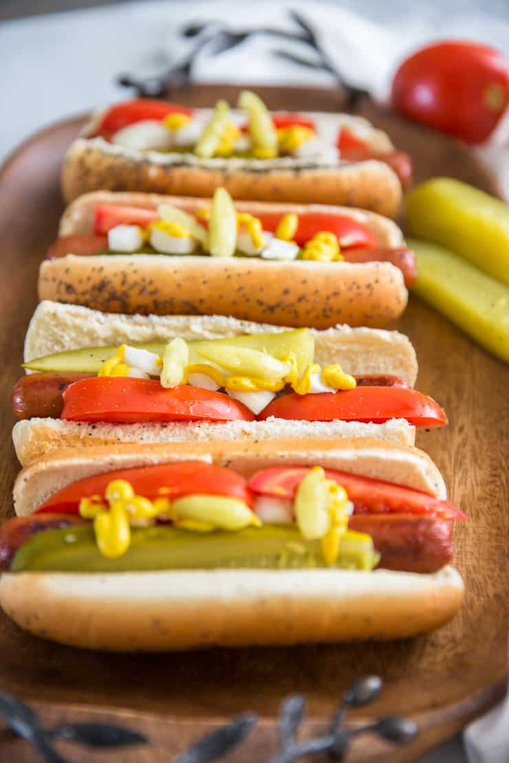 Chicago style hot dogs on a brown tray