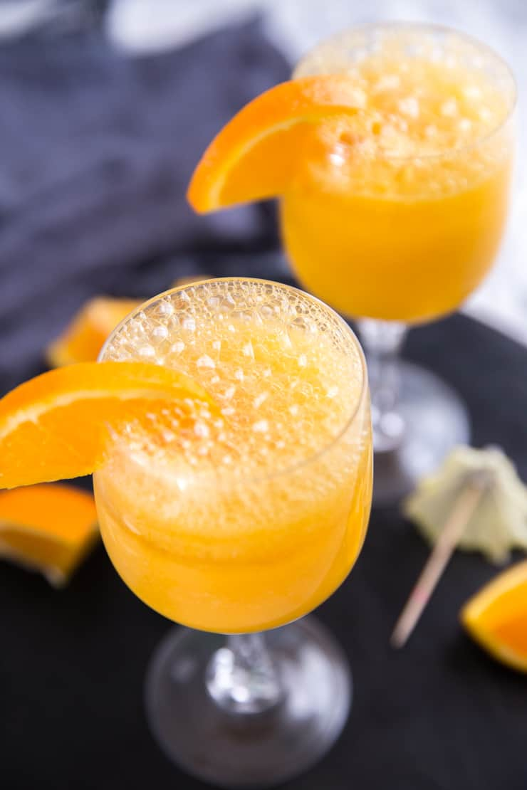 mimosa drink with bubbles and an orange slice