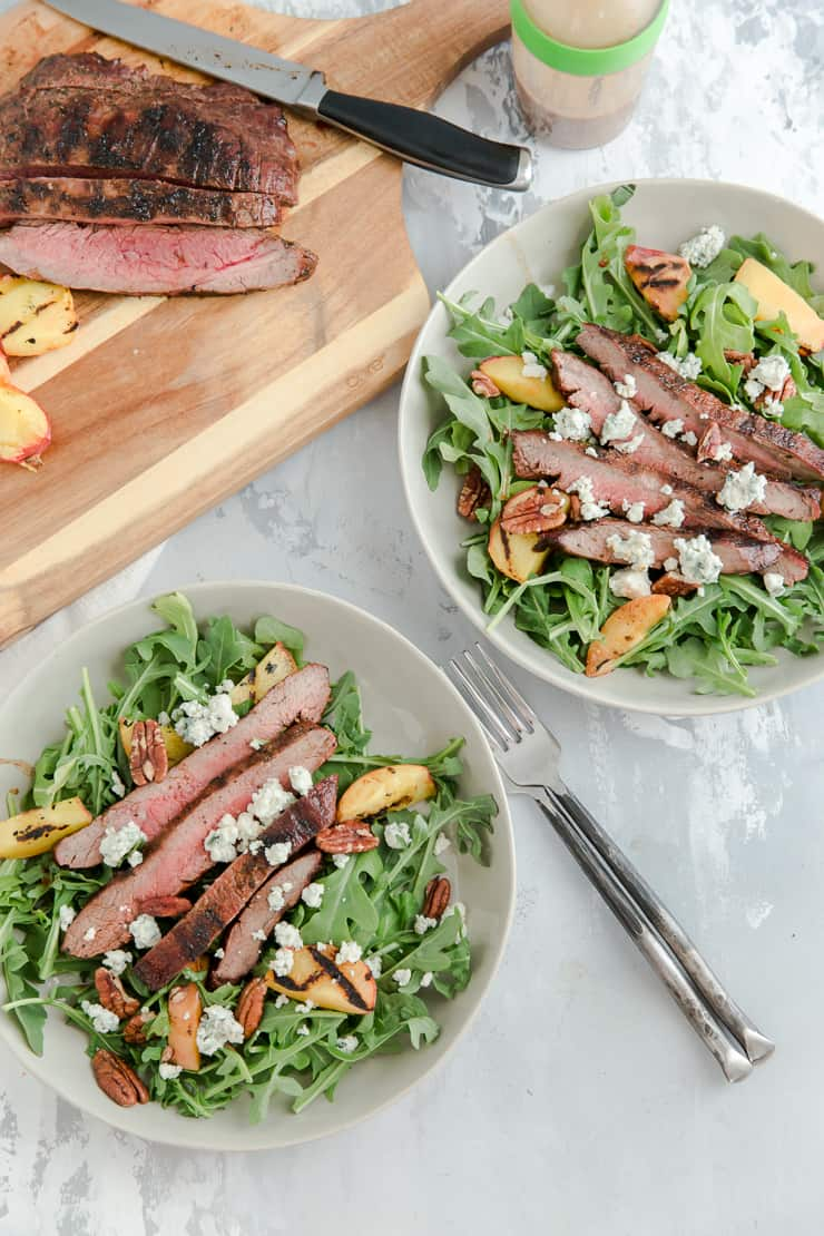 two bowls of black and blue steak salad