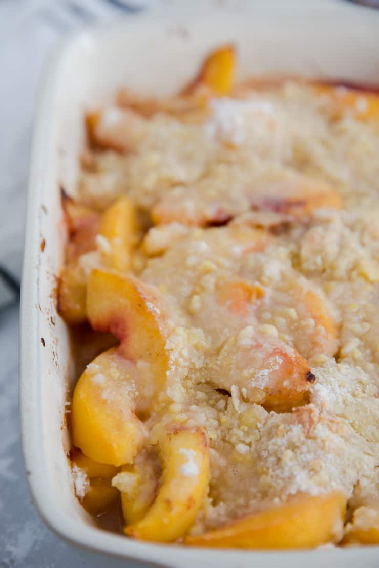 close up few of peach cobbler from the side