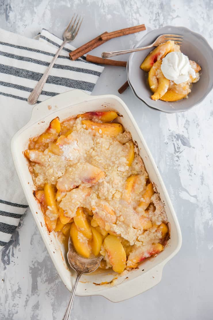 peach cobbler dip with a bowl served on the side
