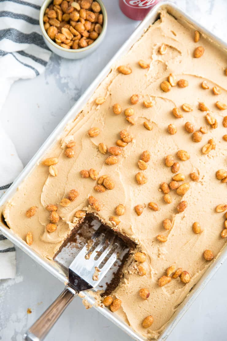 peanuts and coke cake with a piece taken out