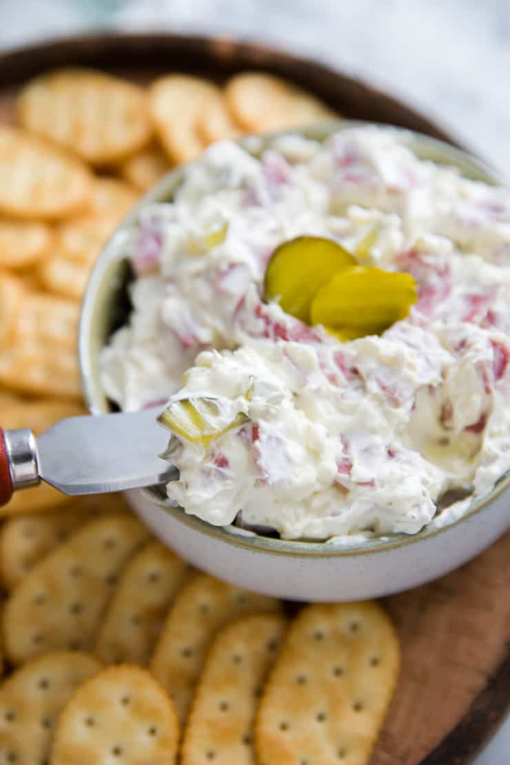 dill pickle dip with spreading knife