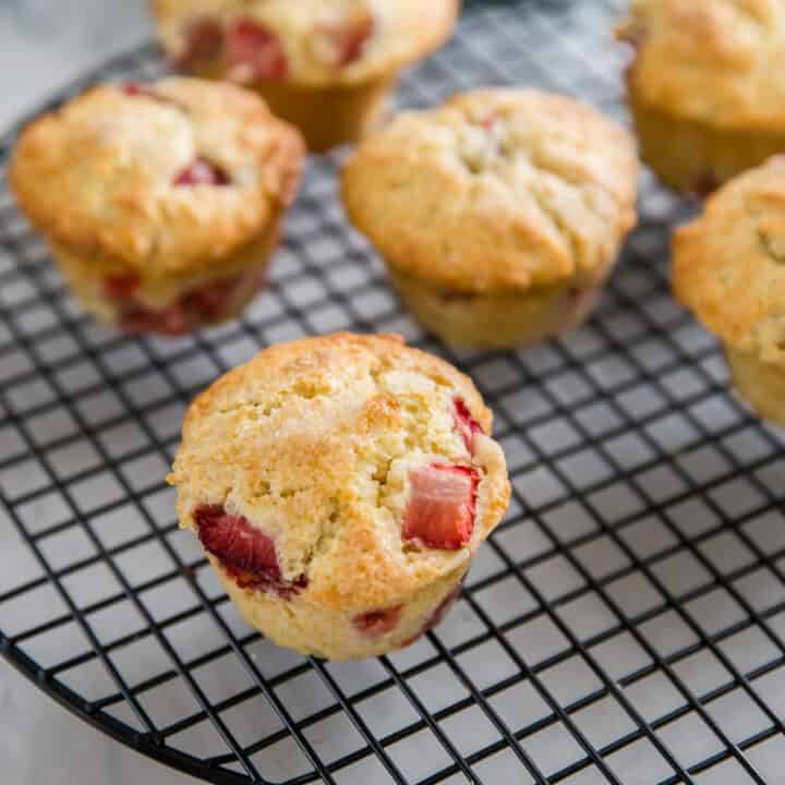 strawberry muffins on a baking rack