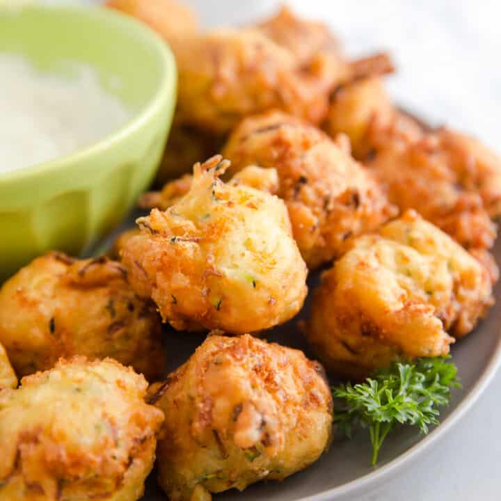 zucchini fritters on a gray plate