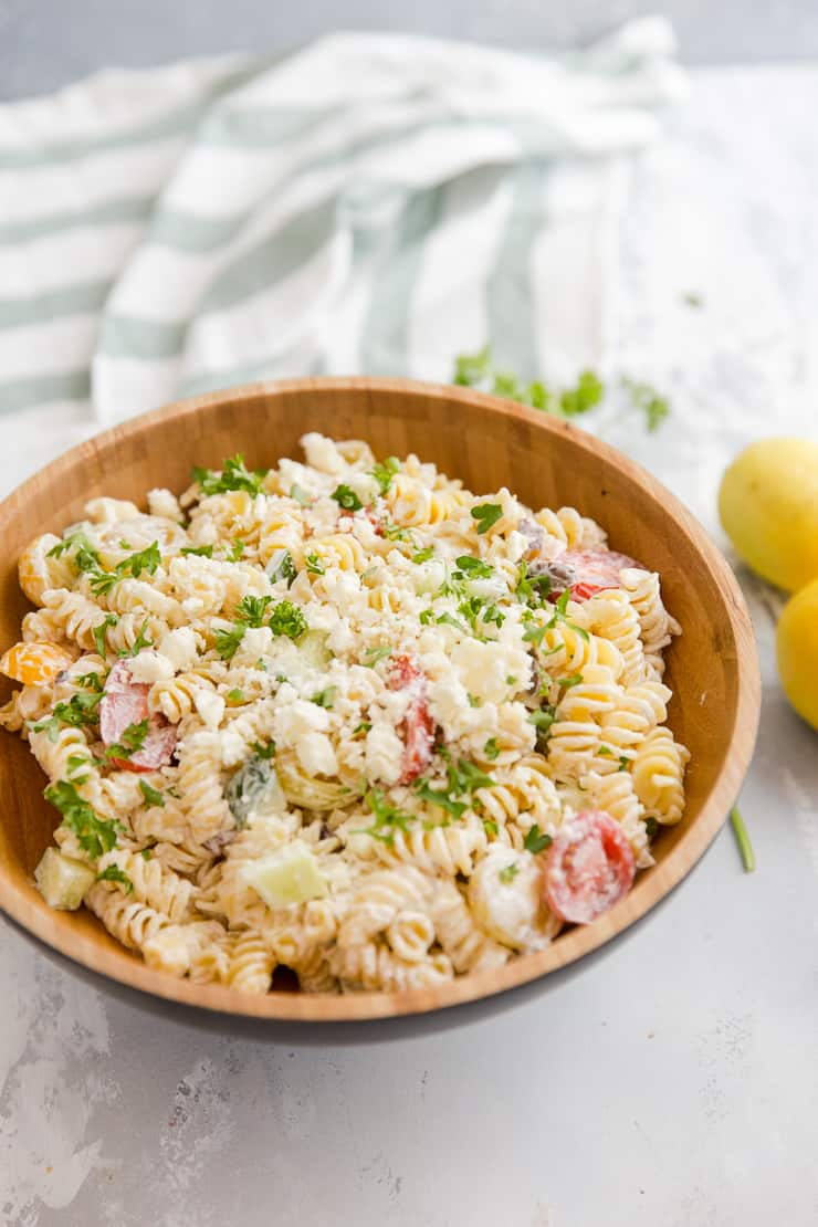 Greek pasta salad with feta cheese crumbles on top