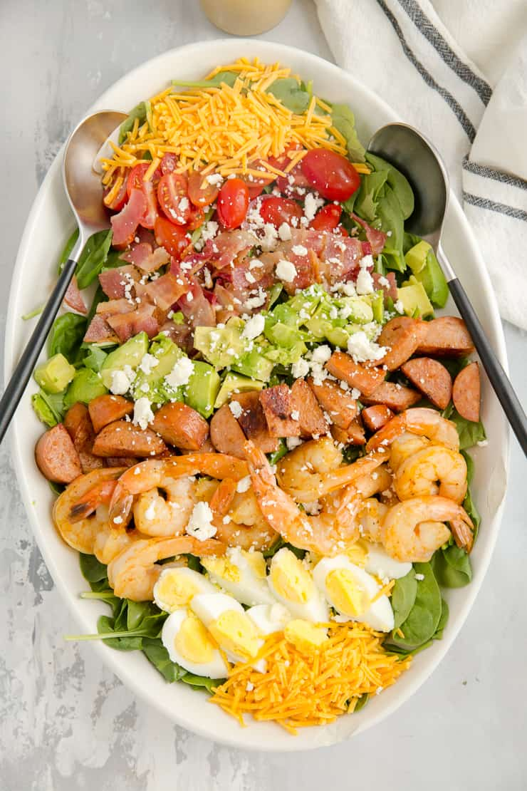 creole shrimp cobb salad ready to be served