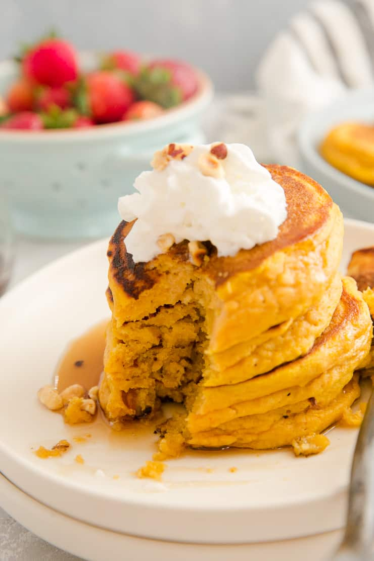 stack of pumpkin pancakes with a bite out