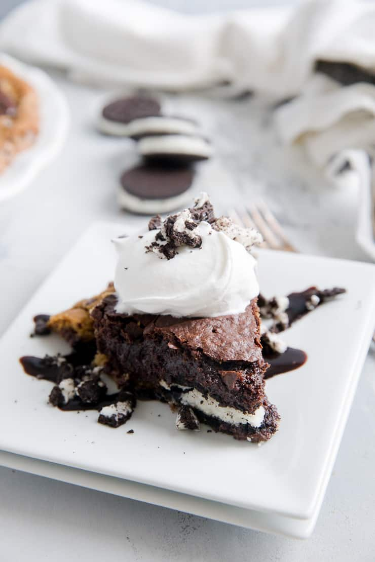slutty brownie pie piece on a plate