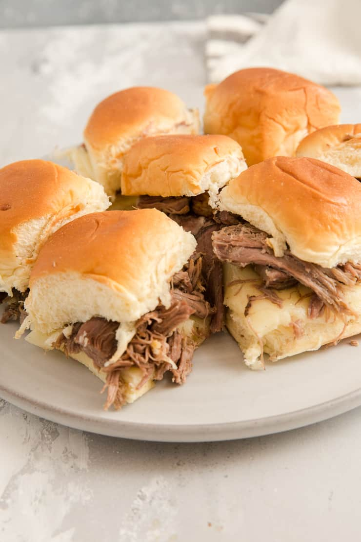 mini French dip sandwiches on a plate