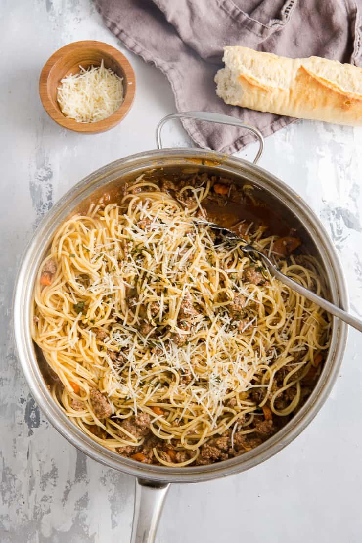 ragu sauce with pasta in a saucepan