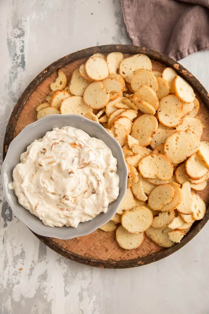 onion dip on a tray with crackers