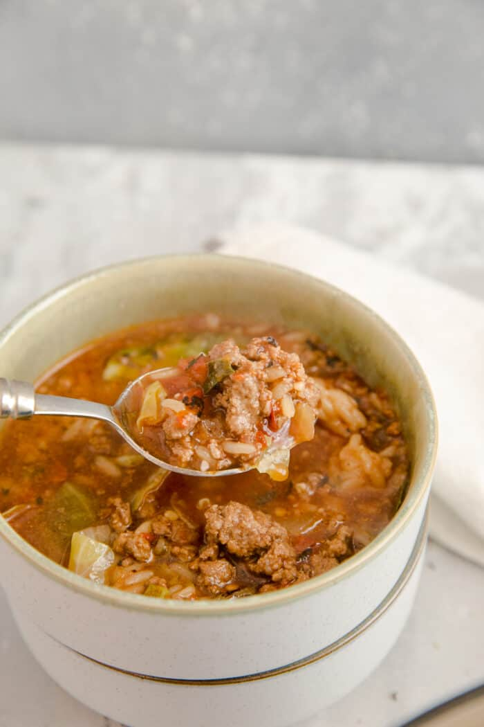 spoon in a bowl of cabbage roll soup