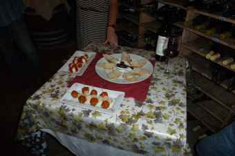 Wine and snacks in the cellar. Unfortunate tablecloth.