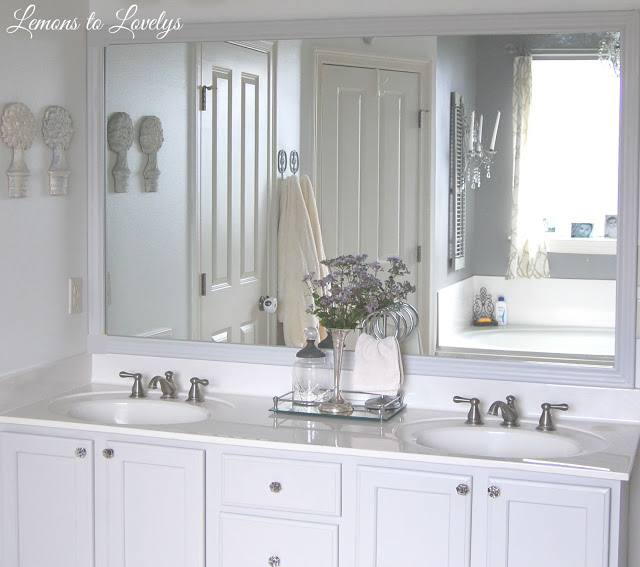 Bathroom Cabinet Makeover & DIY Mirror Frame - Paint color, Stonington Gray by BM - See more pictures on lemonstolovelys.blogspot.com