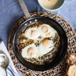 Baked Eggs in Sauteed Greens with Zesty Yogurt Sauce Recipe.