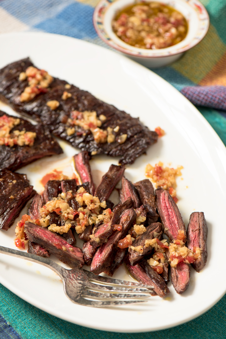 Grilled Skirt Steak with Mojo de Ajo recipe. A sublime recipe for grilled skirt steak with sweet garlic flavor from Mojo de Ajo, a citrus garlic olive oil from Veracruz.
