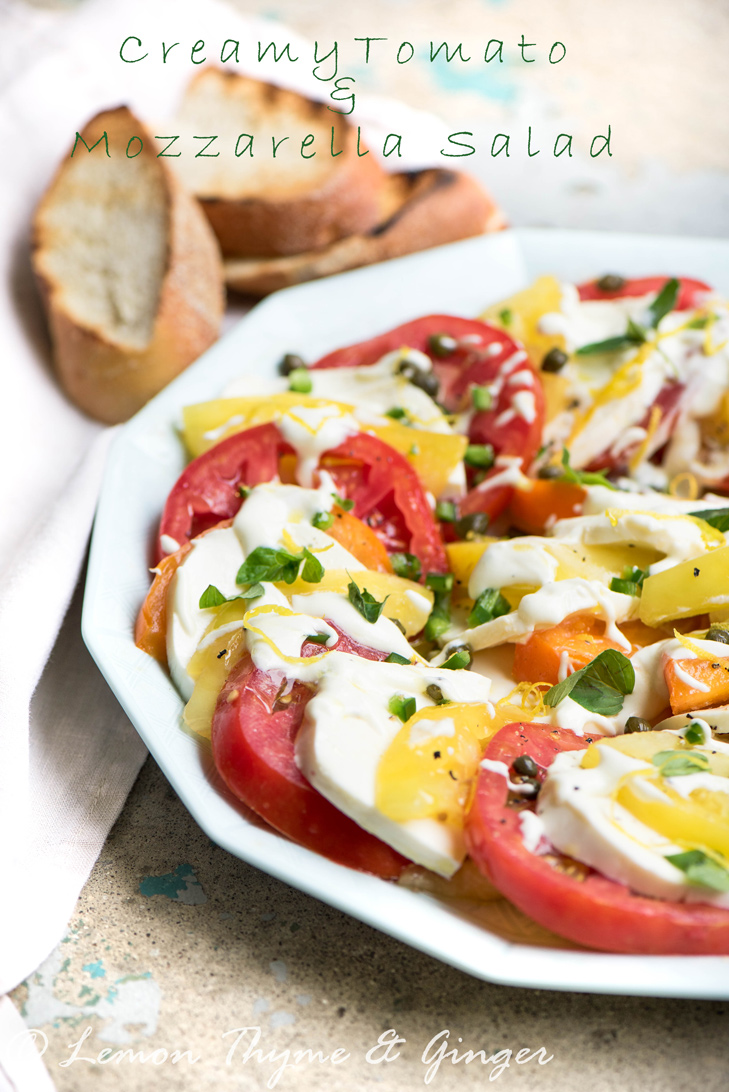 Creamy Tomato and Mozzarella salad recipe. A fresh and brights tasting tomato and mozzarella salad with a luxurious lemon cream dressing and topped with minced jalapeno, capers and fresh herbs.