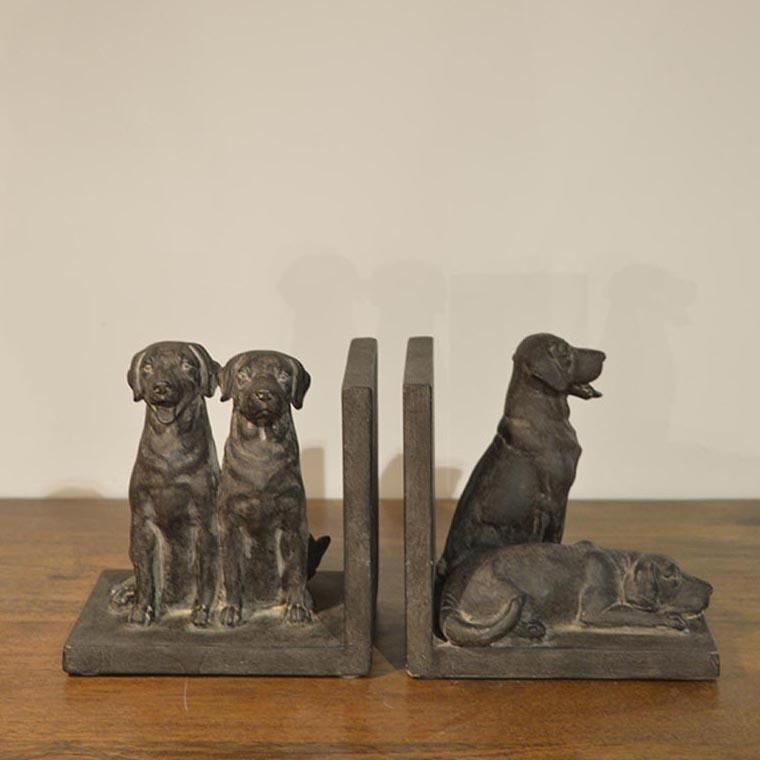 fermalibri 4 cani seduti