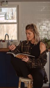 girl reading cookbook