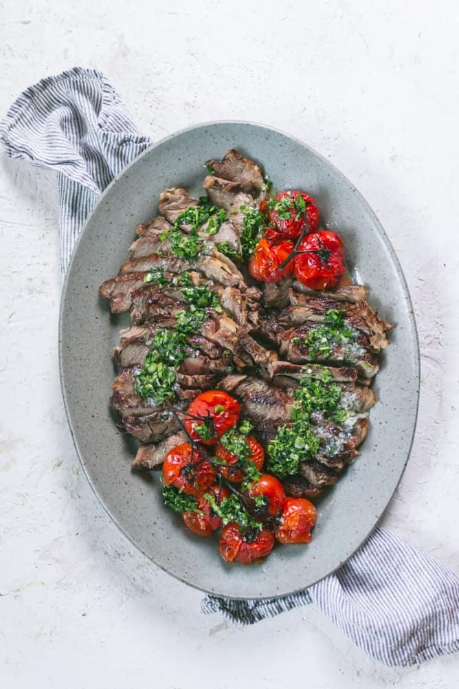ribeye steak with chimichurri sauce and roasted tomatoes
