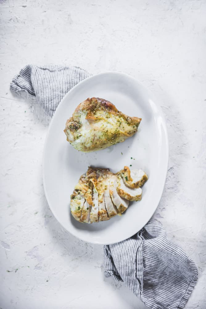 Juicy cooked everyday baked chicken breast with olive oil and onion salt