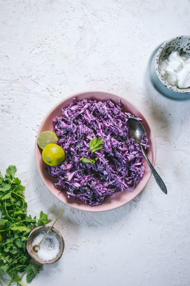 purple cabbage slaw with yogurt, cilantro and lime sauce