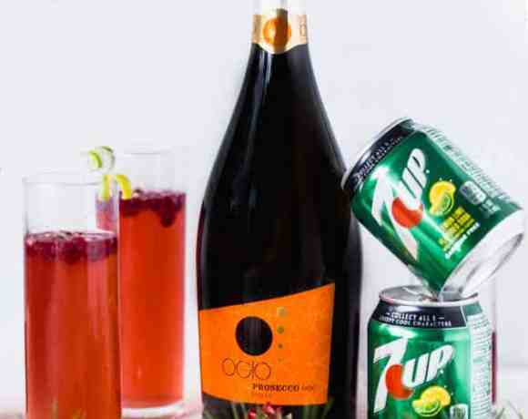 This festive and pretty Pomegranate Tangerine Bellini is made with the sweet and tart combo of tangerine and pomegranate. #cocktail #drink #holidayparty #bellini #mimosa #citrus #pomegranate #cheers #easycocktail #bubbles #prosecco