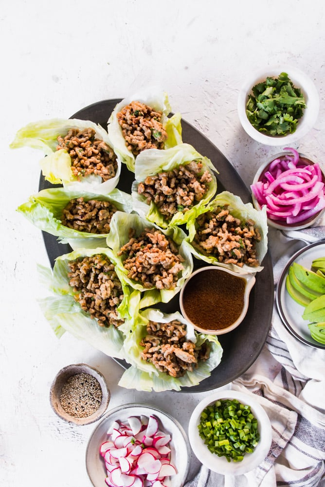 Low Carb Asian Pork Lettuce cups in oval platter. lenaskitchenblog.com