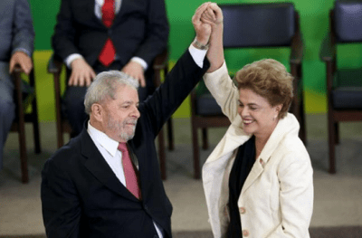Tổng thống Rousseff, phải, chào cựu tổng thống Luiz Inacio Lula da Silva tại lễ tuyên thệ nhậm chức chánh văn phòng của Lula ở Phủ Tổng thống hôm 17-3. (Ảnh: Adriano Machado / Reuters)
