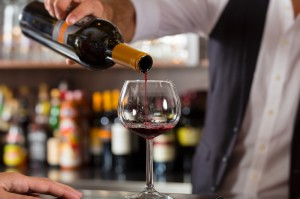 http://www.dreamstime.com/royalty-free-stock-images-barkeeper-pouring-red-wine-glass-bar-restaurant-hotel-image30194049