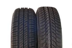 http://www.dreamstime.com/royalty-free-stock-photo-summer-winter-car-tires-brand-new-modern-image31436575