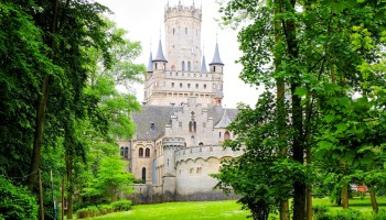 Tree-lined path leading to Marienburg Castle