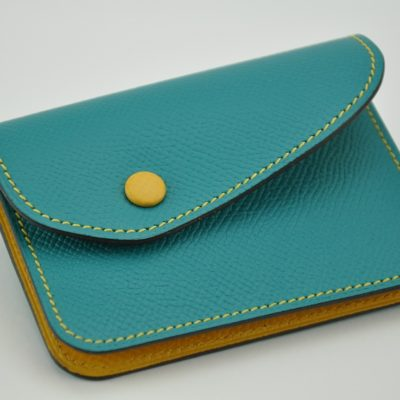 Woman purse with grained calfskin turquoise and yellow. Made in France by luxury leathergoods.