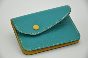 Woman purse in grained calfskin turquoise and yellow. Made in France by luxury leathergoods.