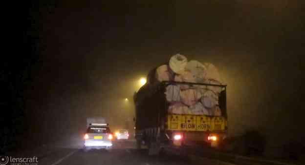 traffic through the fog / near sikri, india