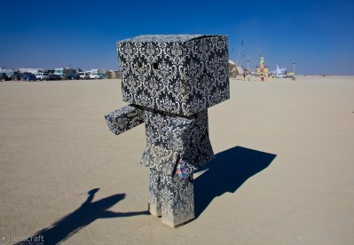 sad paisley robot gets a hug / black rock city, nevada