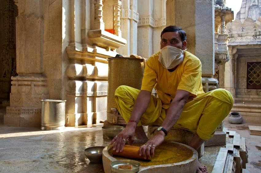making vermilion powder / jain temple, india