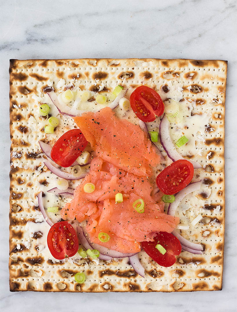 matzah with lox, cream cheese, onion, and tomato