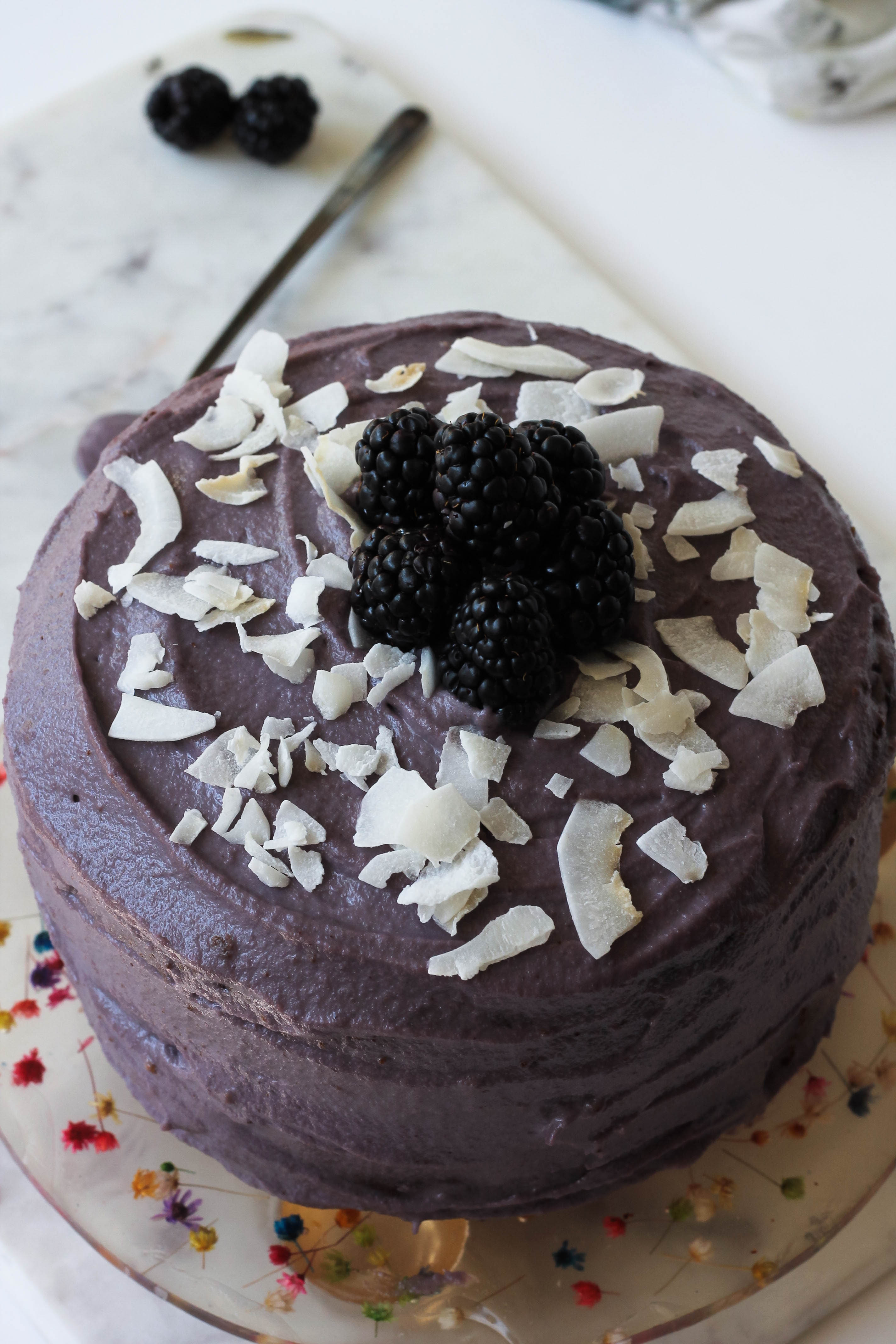 vanilla coconut cake with blackberry frosting