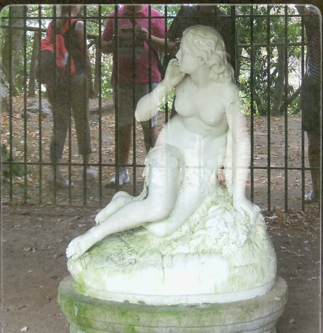Statue of Eve-who appears to turn surprised to be caught naked