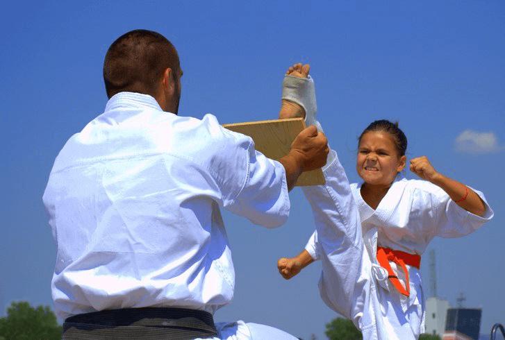 Leominster Martial Arts_Jr Tai Jutsu female breaking board