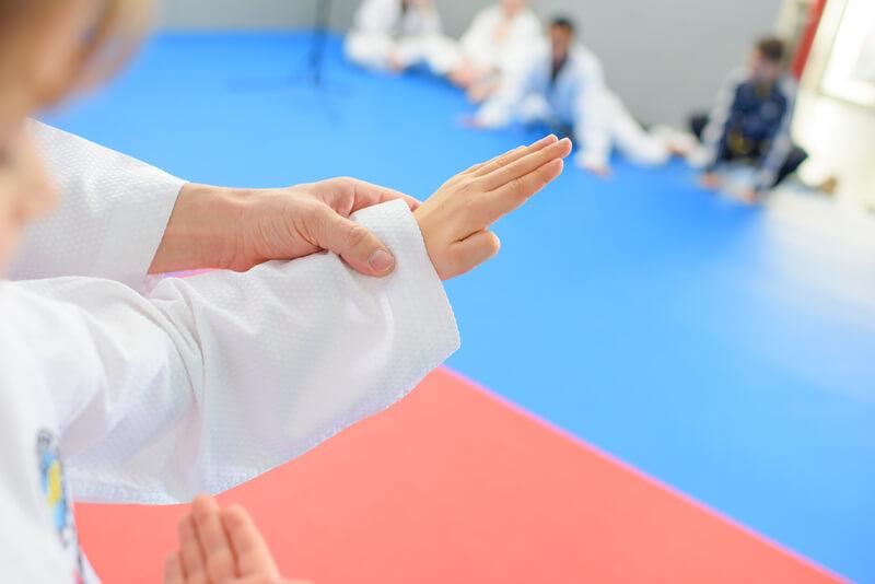 child martial artist receiving guidance