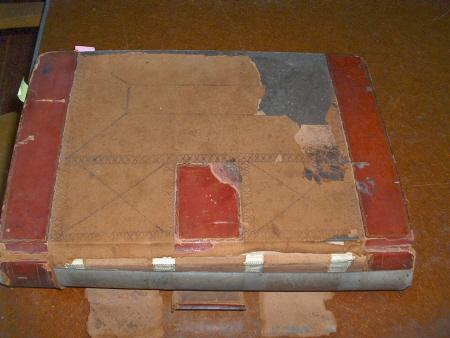 Before pic of deteriorated calfskin bound ledger circa 1880s