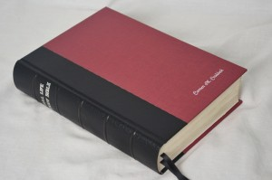 A Bible bound as a hardcover in bookbinding cloth and imitation leather cloth
