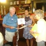 Joh Seymor presents new member Angie Hughes her membership packet.