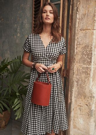 french girl with a gingham summer dress